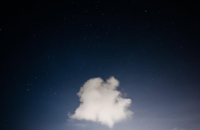 Single cloud against a dark sky