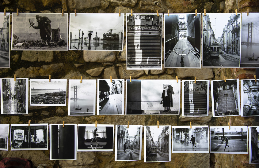 black and white pictures hung against a wal