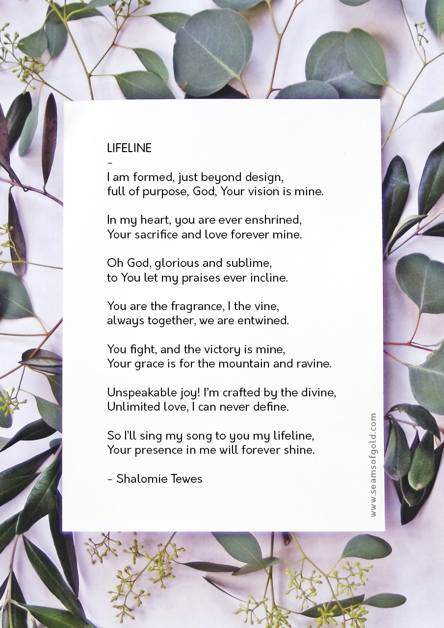 poem on paper placed on leaves