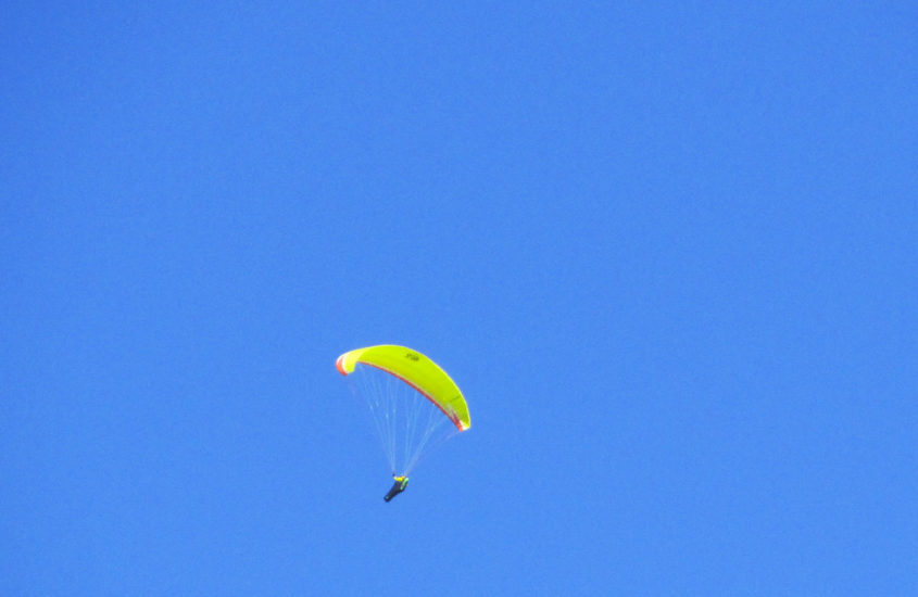 person gliding in blue sky